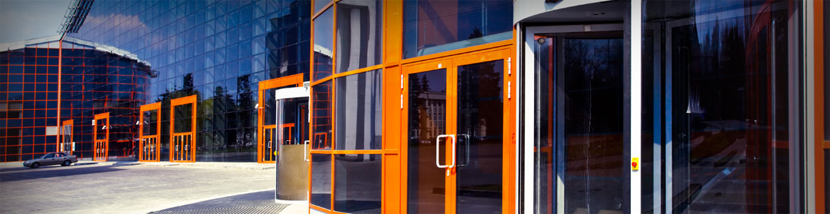 Office building entrance with double glass doors.